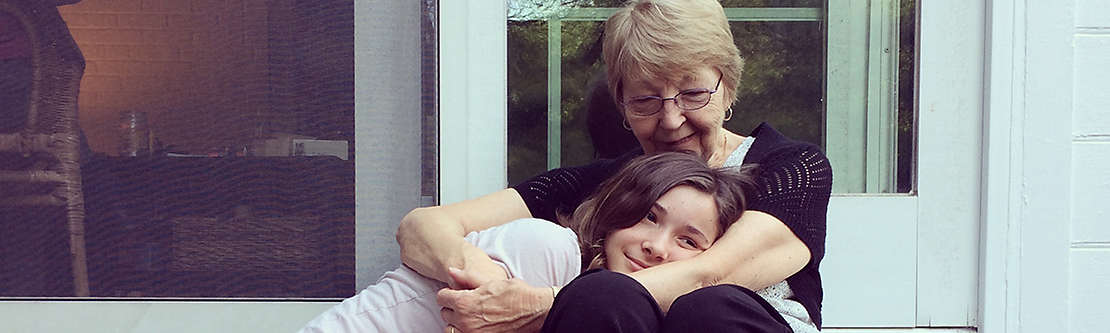 Grandmother and granddaughter hugging