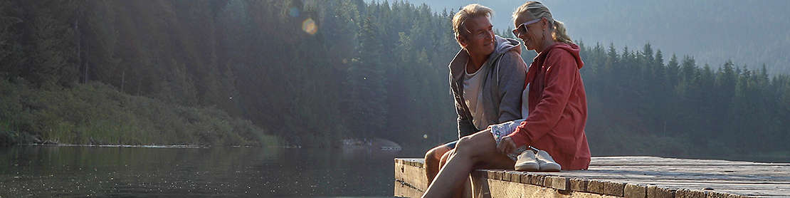 Mature couple spending time together at a lake.