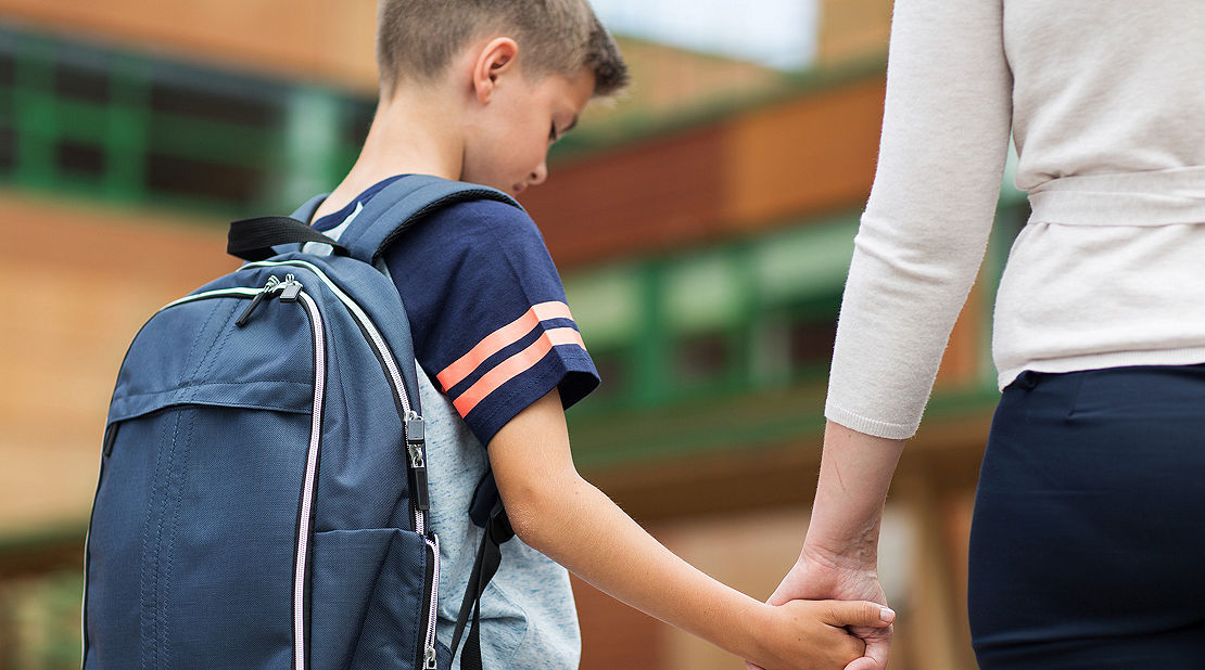 mom walking her kid to school