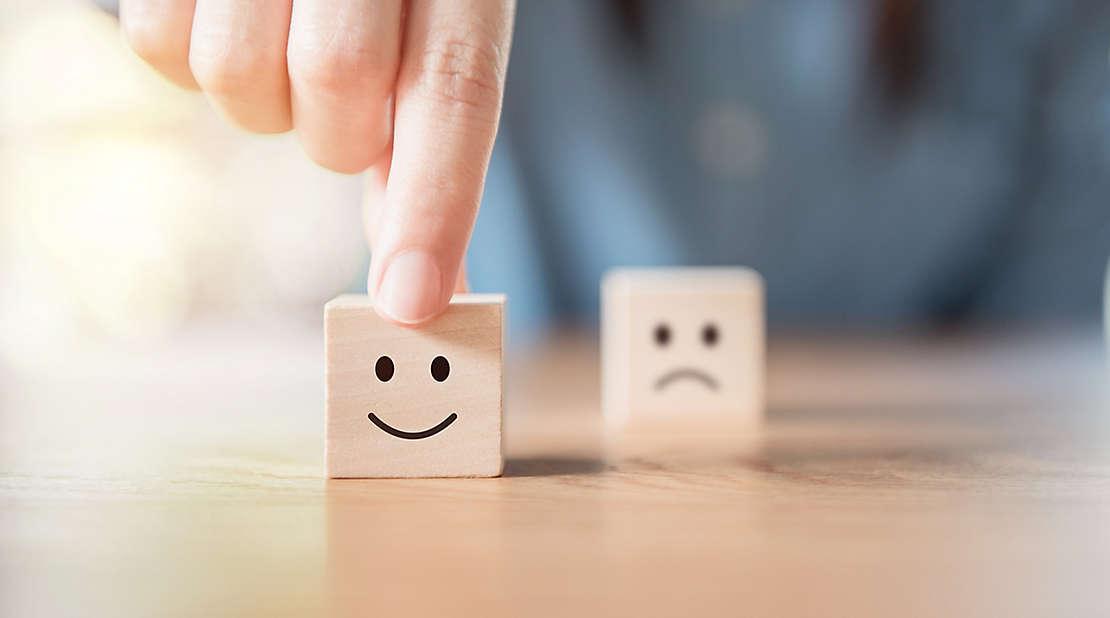 happy and sad face wooden blocks