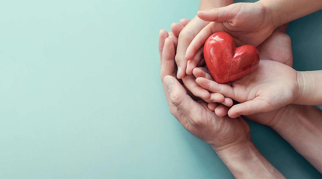 adoption image, hands heart