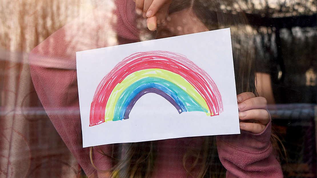 Child drawing rainbow