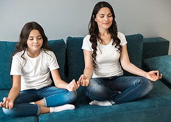 mother daughter meditating