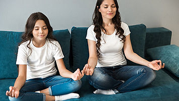 mother daughter meditating