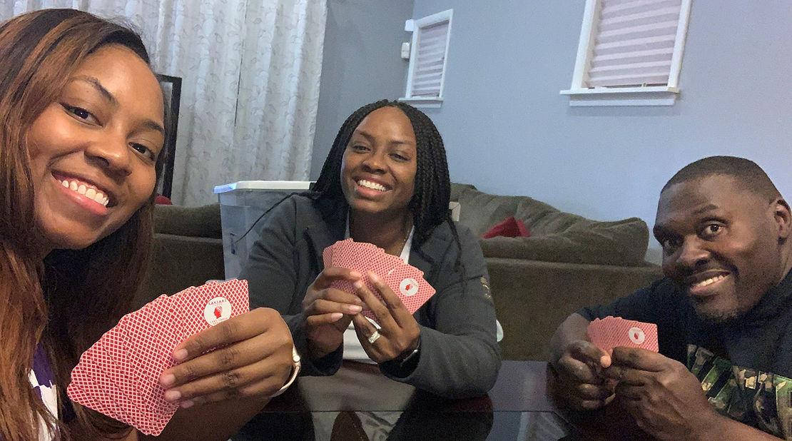 Office Coordinator Kenya Stewart playing cards.