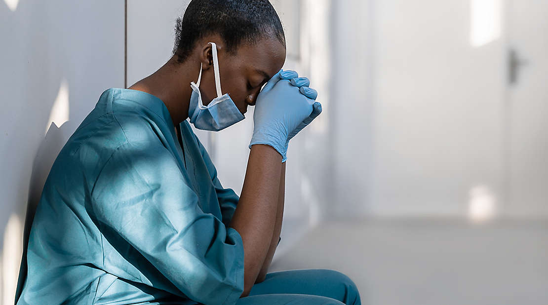 A female medical professional thinking.