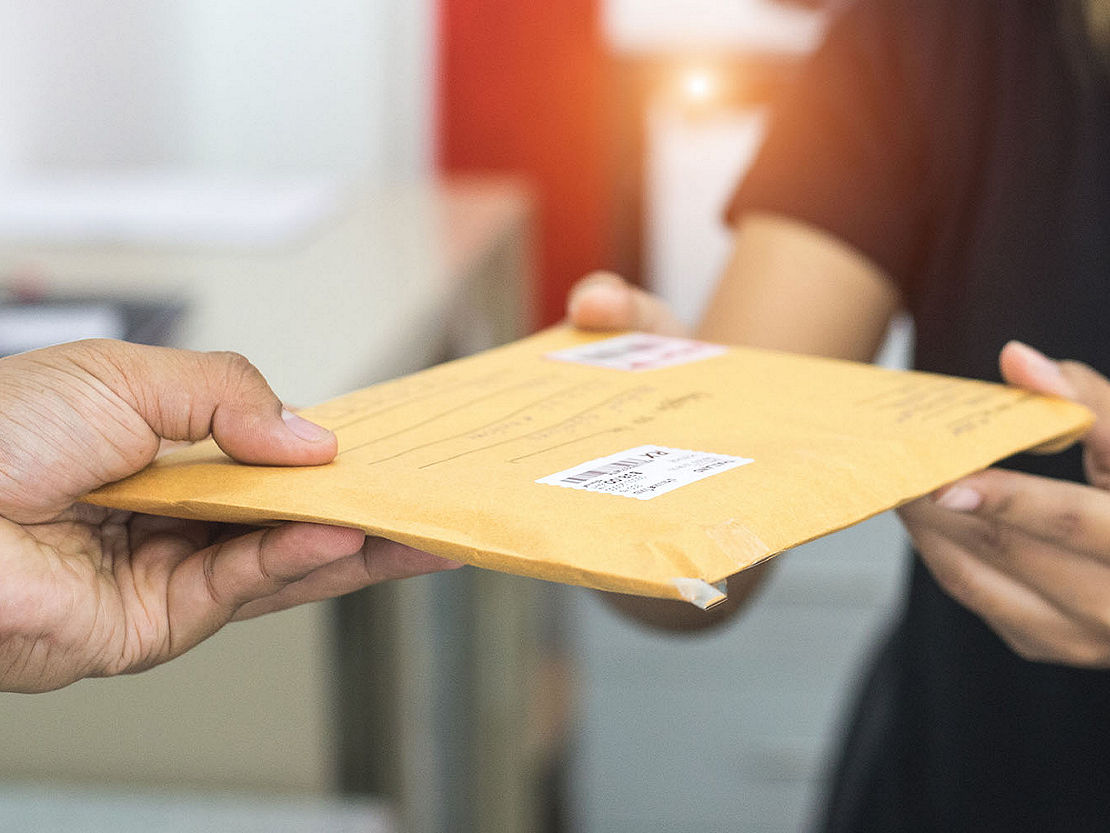 Handing over package to be sent in the mail