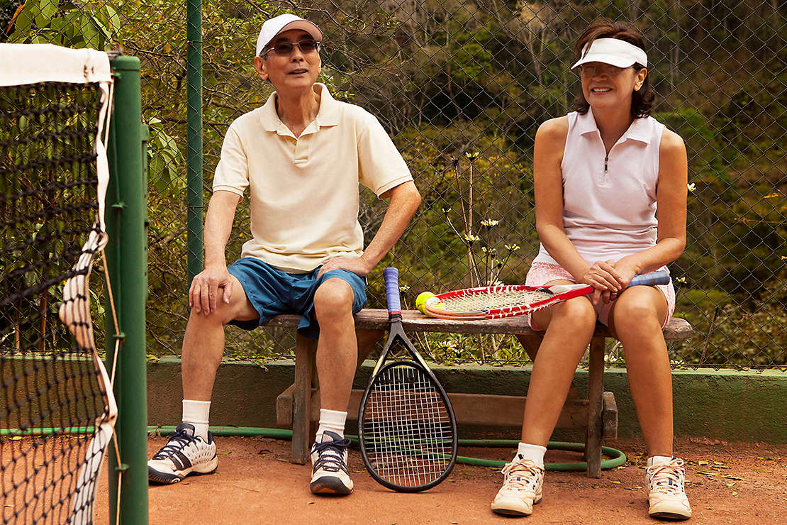 Older couple playing tennis