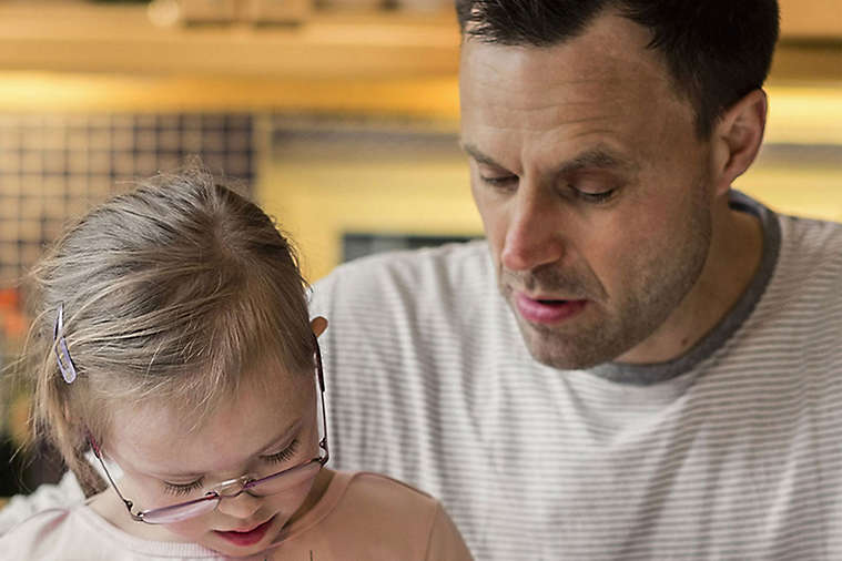 Dad and daughter doing art work
