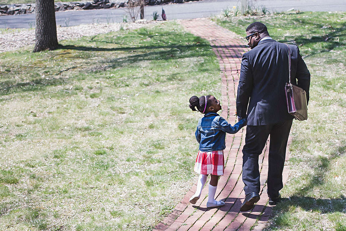 father and daughter leave the house holding hands