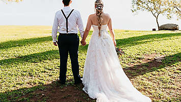 Couple standing outside on their wedding day.