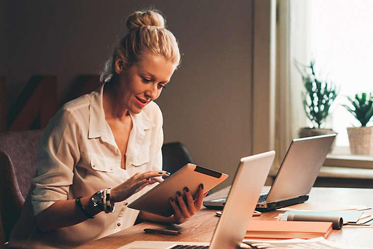 Women working at her desk.
