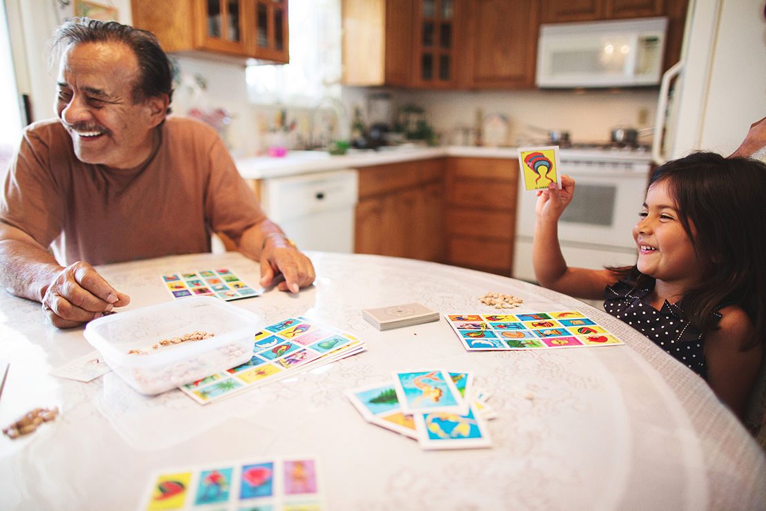 Grandpa and granddaughter play a board game