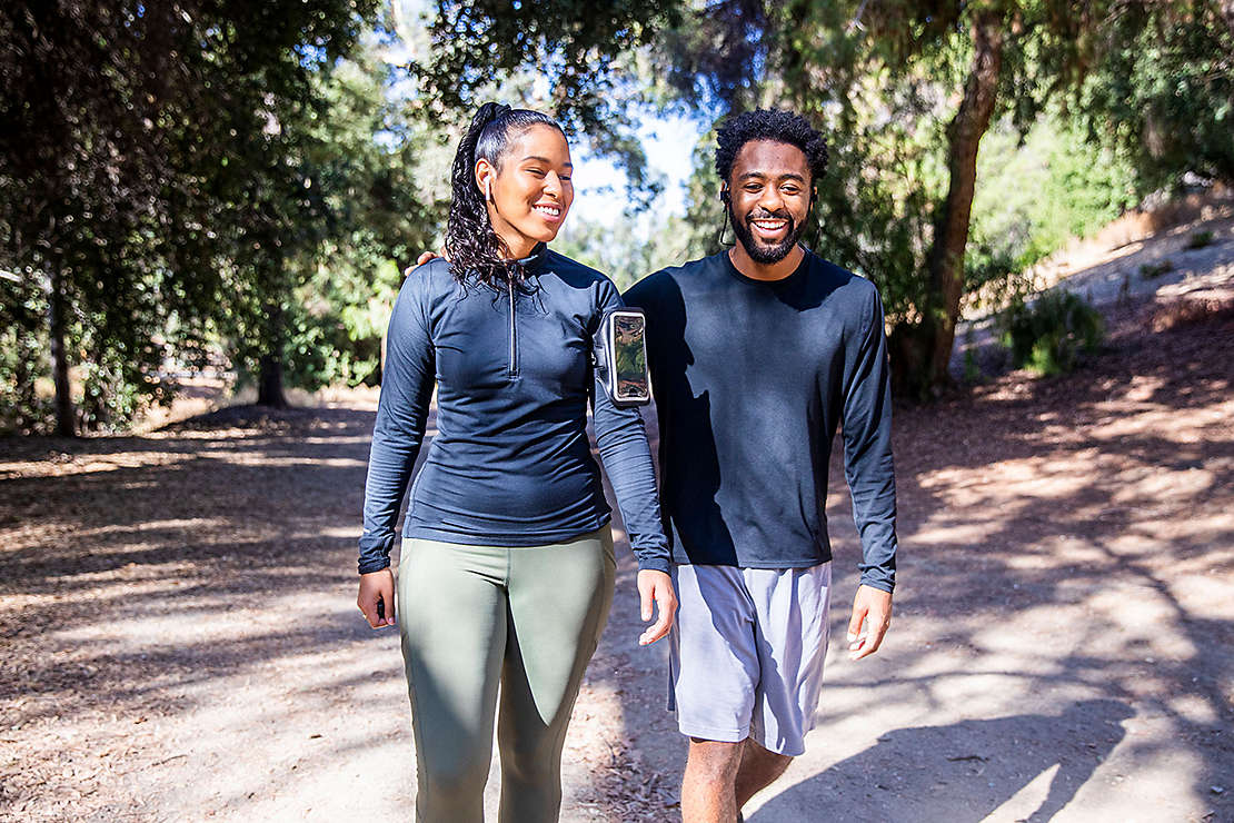 Couple walking on a trail after a workout
