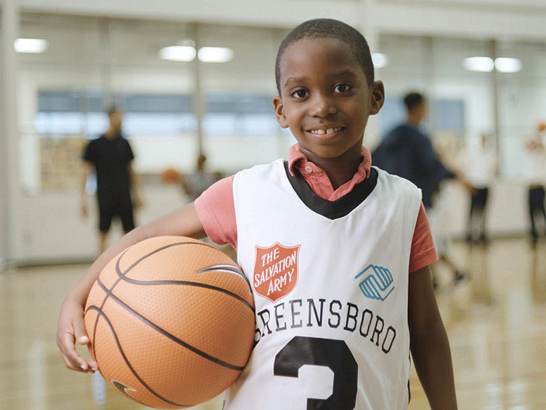 Young boy holding basketball in Greensboro, North Carolina