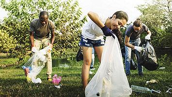 Employees picking up trash