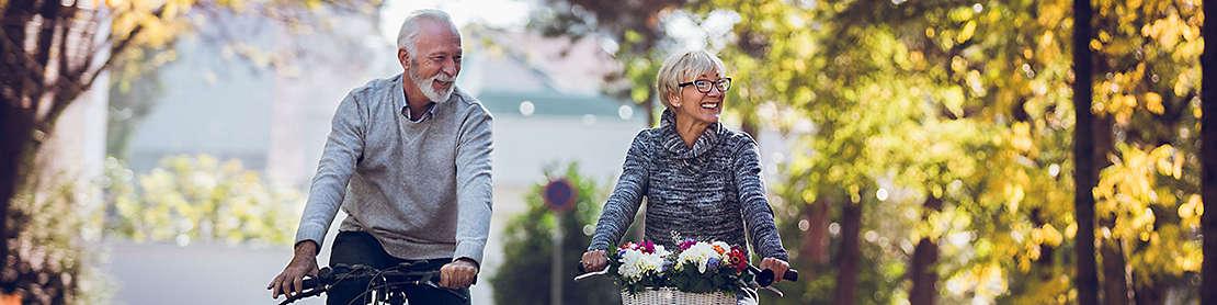 Senior couple riding bikes.