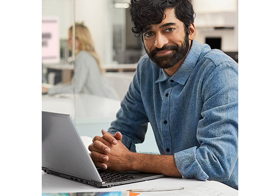 Man working with a laptop in an office
