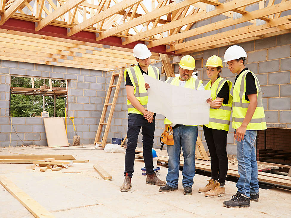 Construction crew reading blueprint