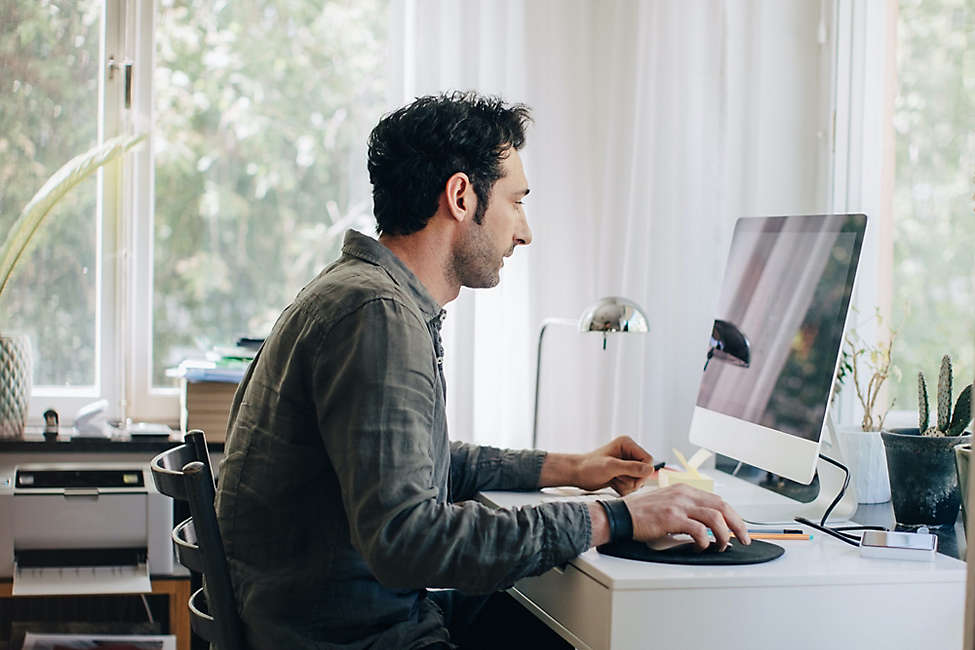 Corporate man working at computer