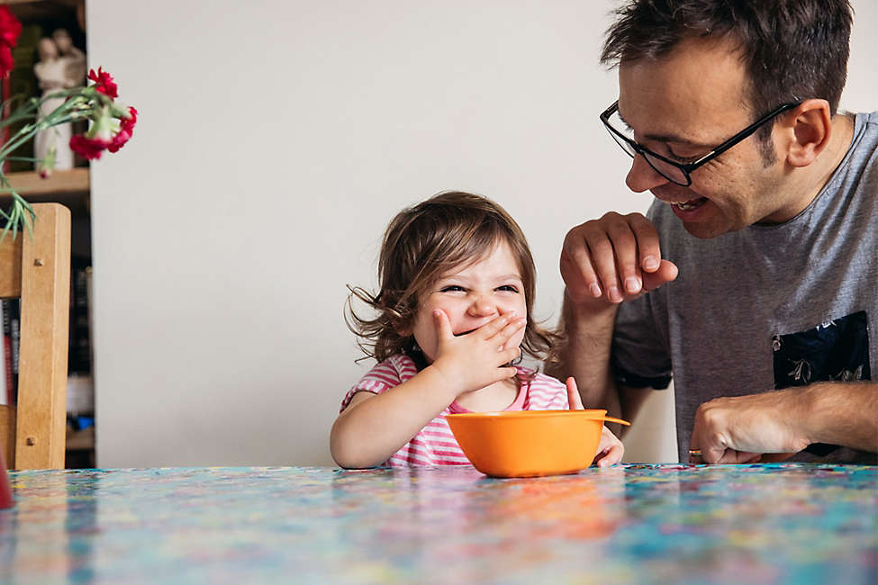 Dad and daughter enjoying snack time