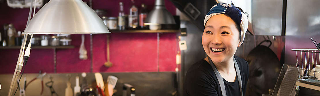 Small business owner working in her kitchen