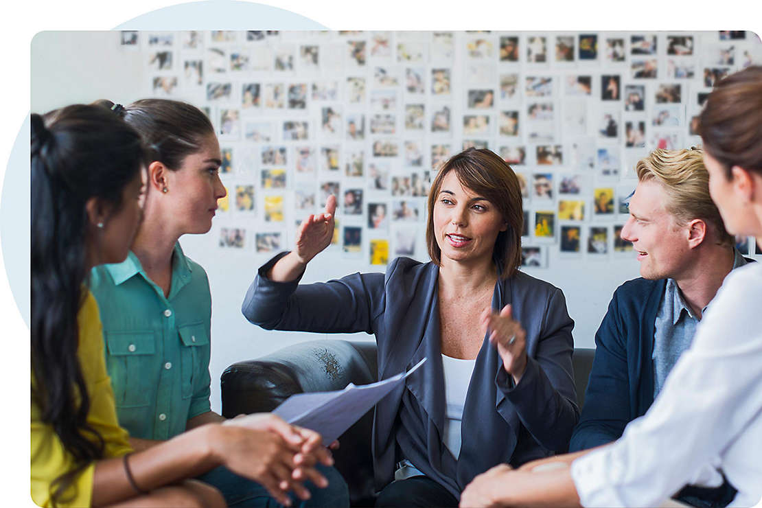 Latin woman mentoring in workplace