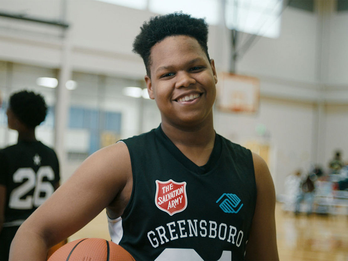 Basketball player portrait holding ball