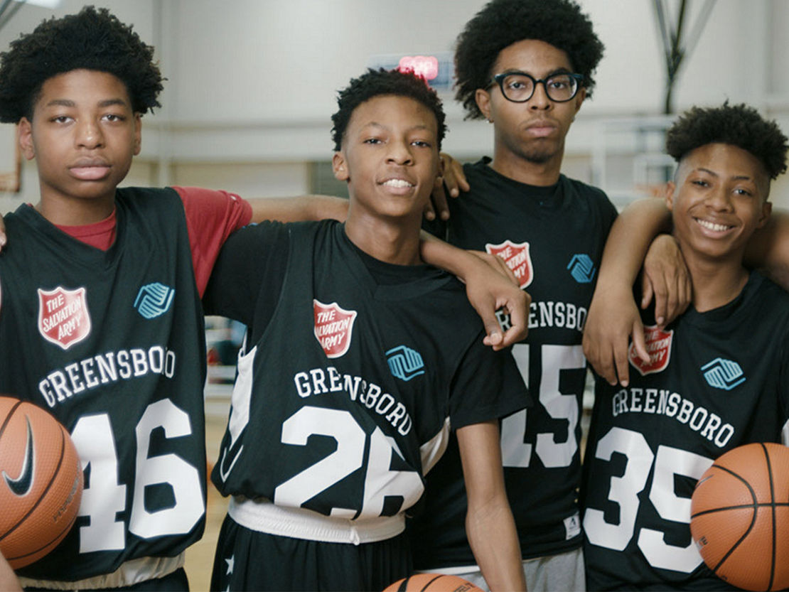 Basketball team photo with four players