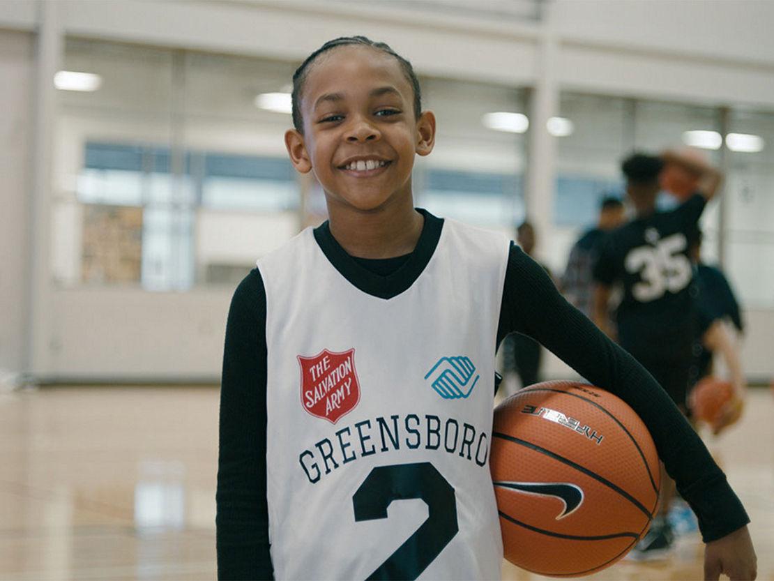 Young basketball player holding basketball