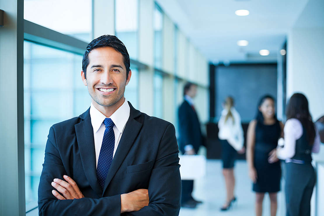 Man in office smiling