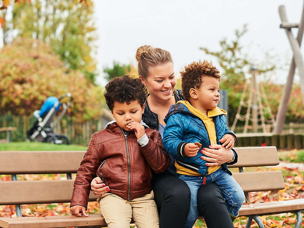Mom on bench with kids