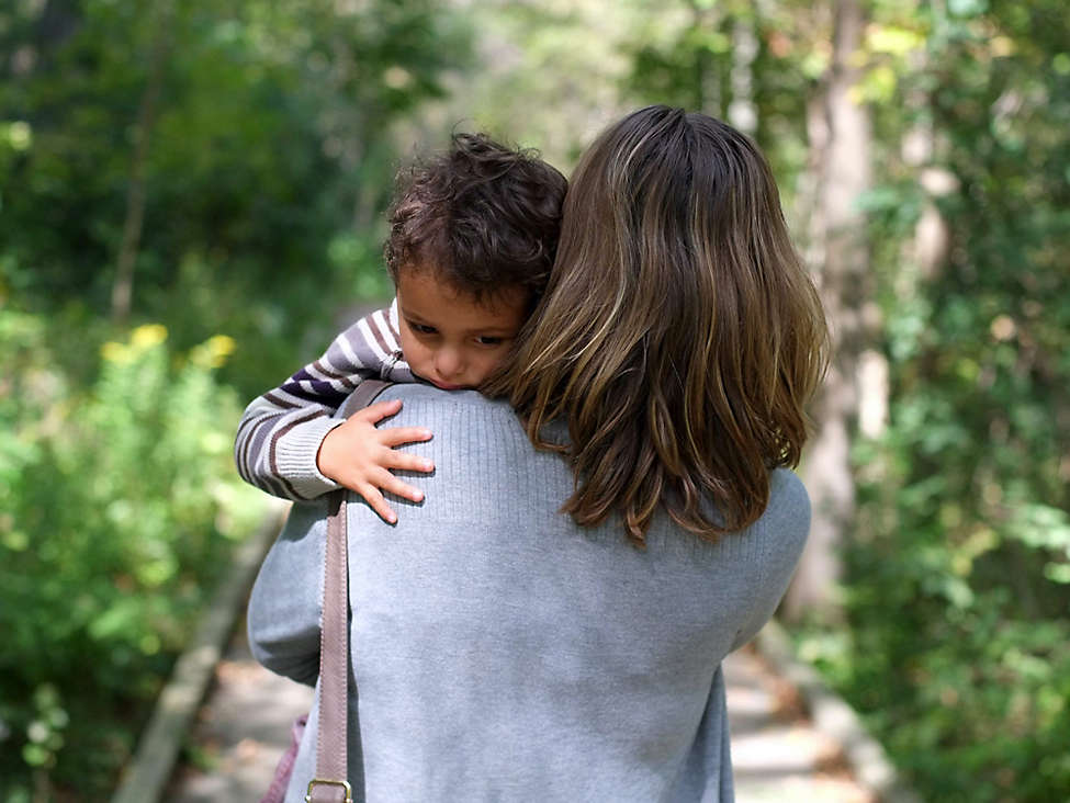Mom walking with son