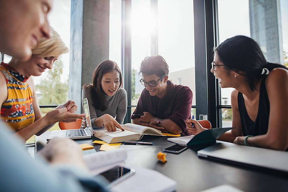 Diverse young group working in office