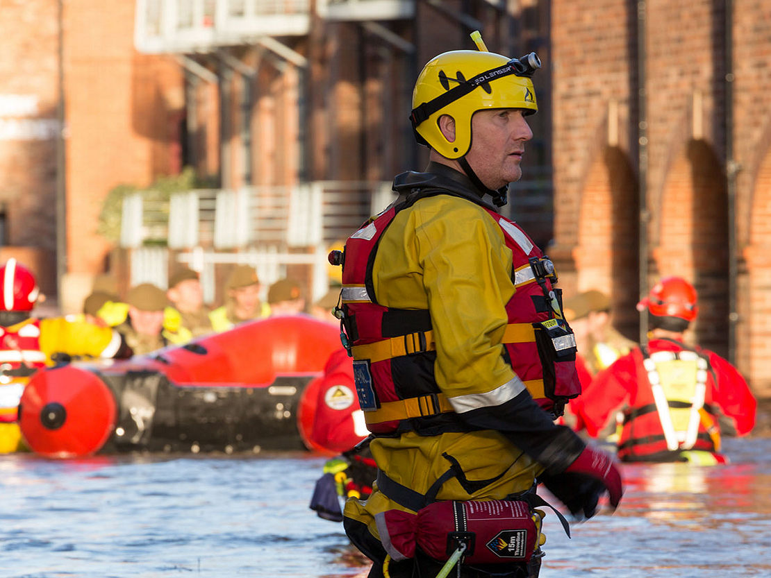 Rescue worker helping during a flood