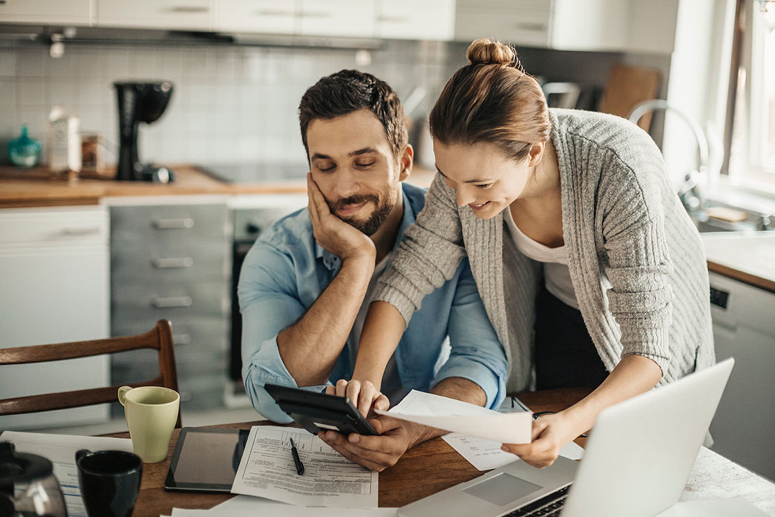 Couple looking over paperwork.