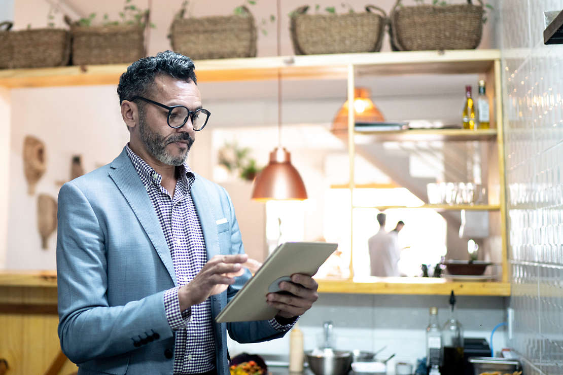 Business owner looking at tablet.