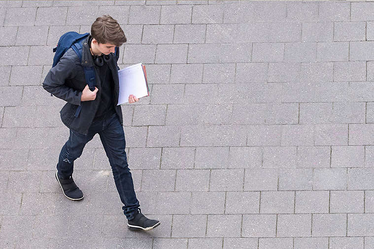 College student walking to class.
