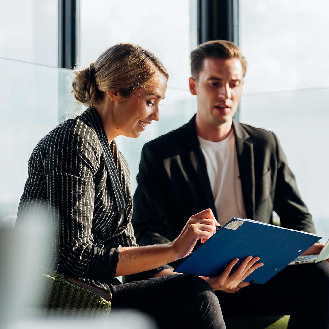Woman and man looking at clipboard