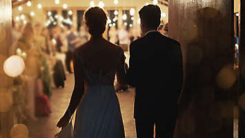 Married couple walking into their reception