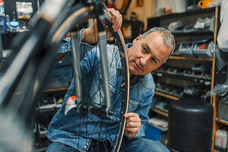 Man working in bicycle shop