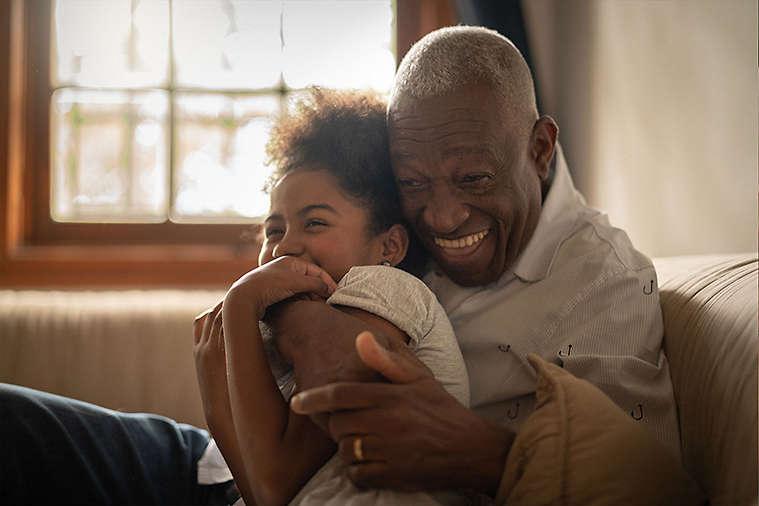 Grandfather hugging his granddaughter