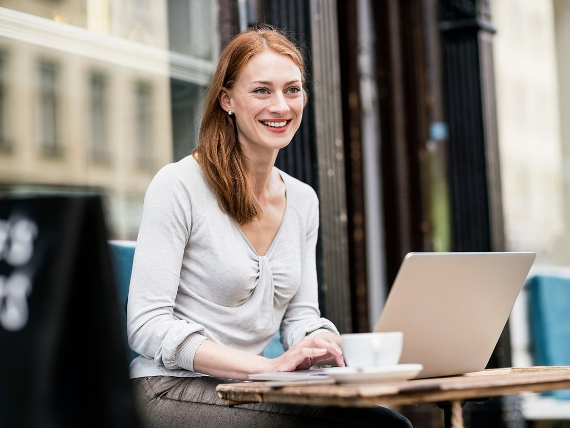 Woman working outside with her laptop.