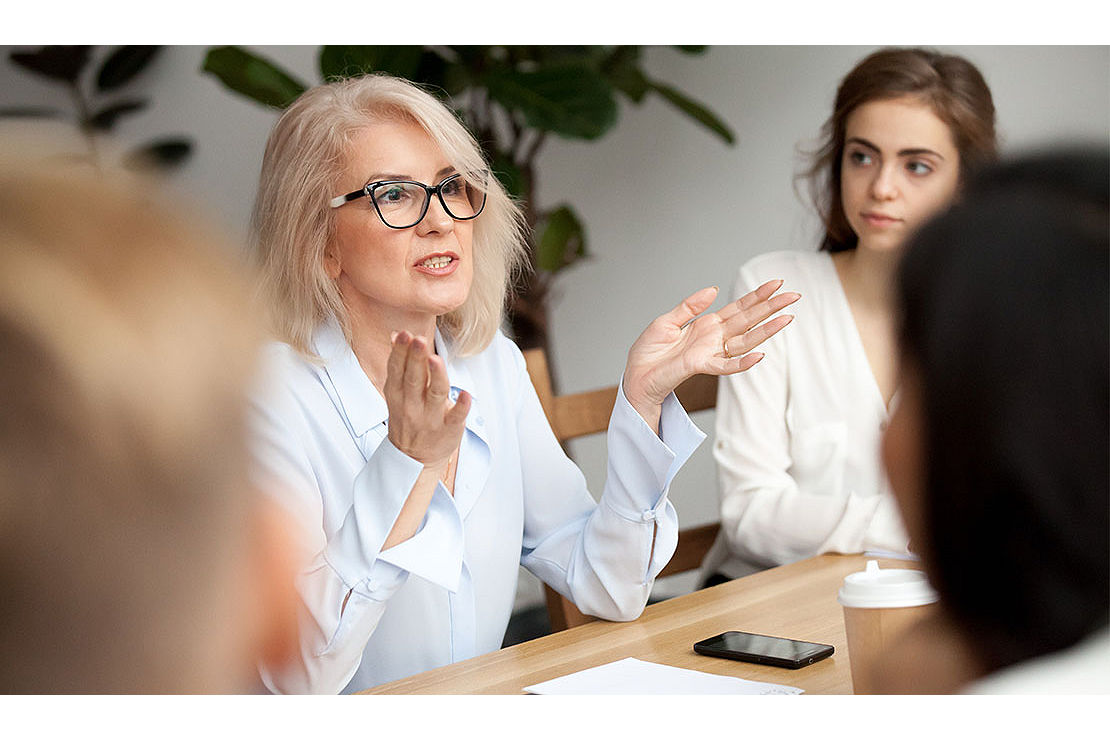 Woman leading an office meeting.