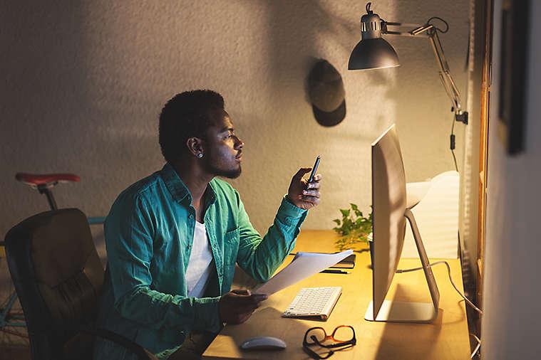 Black Businessman Using Mobile Phone