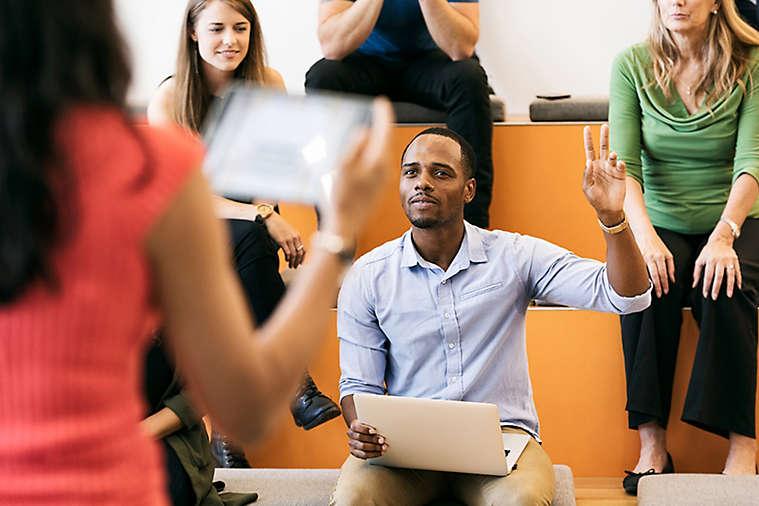 Man raising hand presentation