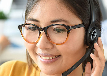 Young woman using a headset