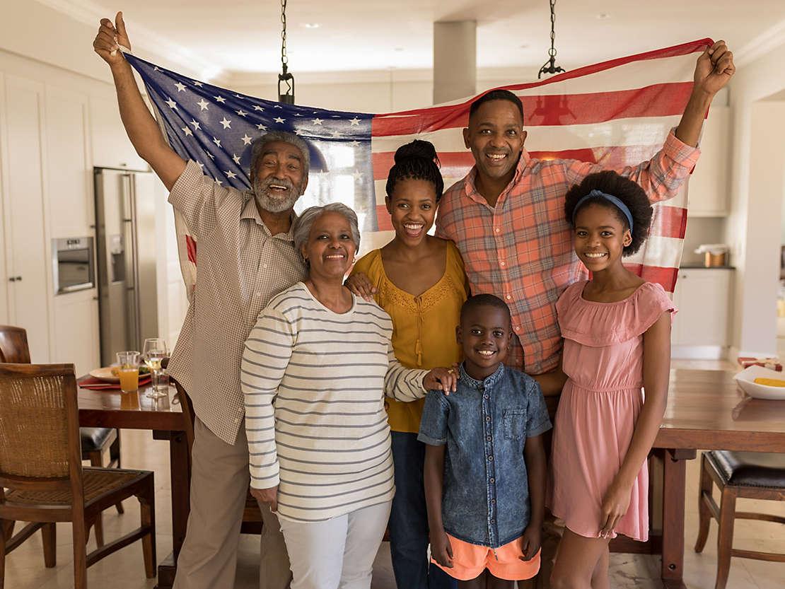 family-holding-american-flag.jpg