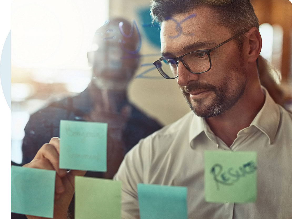Financial professional writes on whiteboard