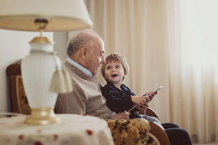Grandfather and grandchild reading